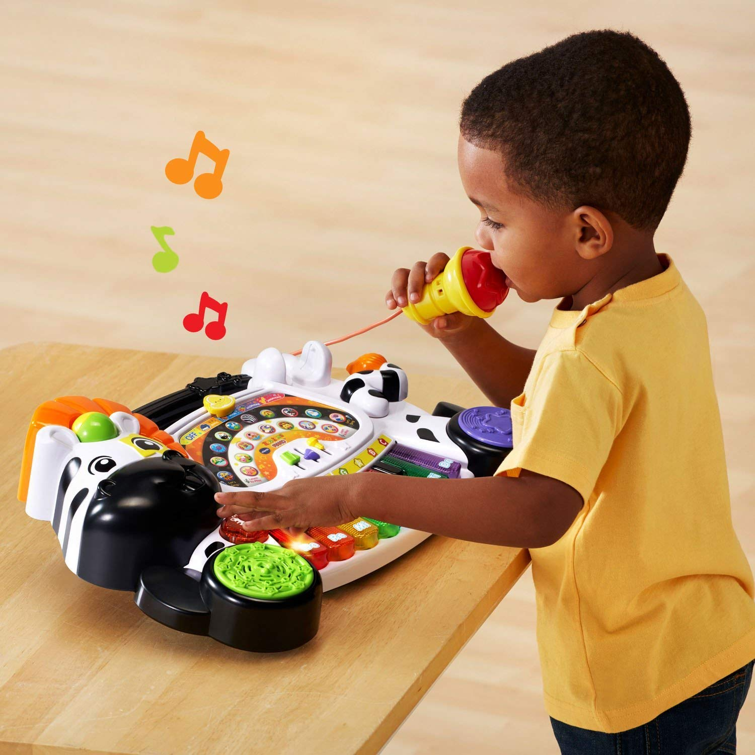toddler with music toy